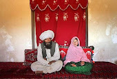 Afghanistan wedding. He is 40 years old, she is 11.