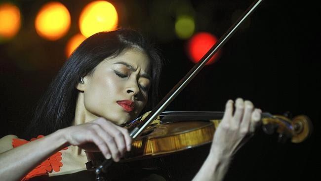sad violinist playing at Sochi Games