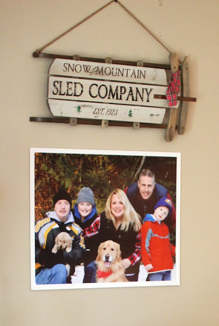 Family picture in snow with Golden Retriever puppy-www.goldenboysandme.com