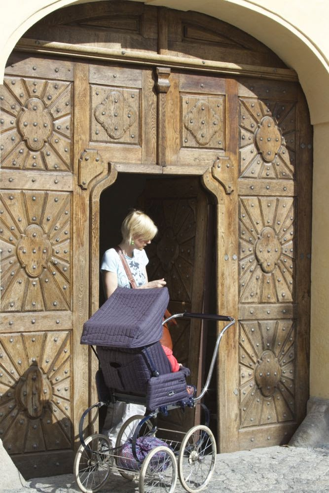 wooden door with mother and child