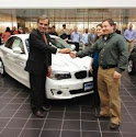BMW President Ludwig Willisch handing me the keys to the very first BMW ActiveE