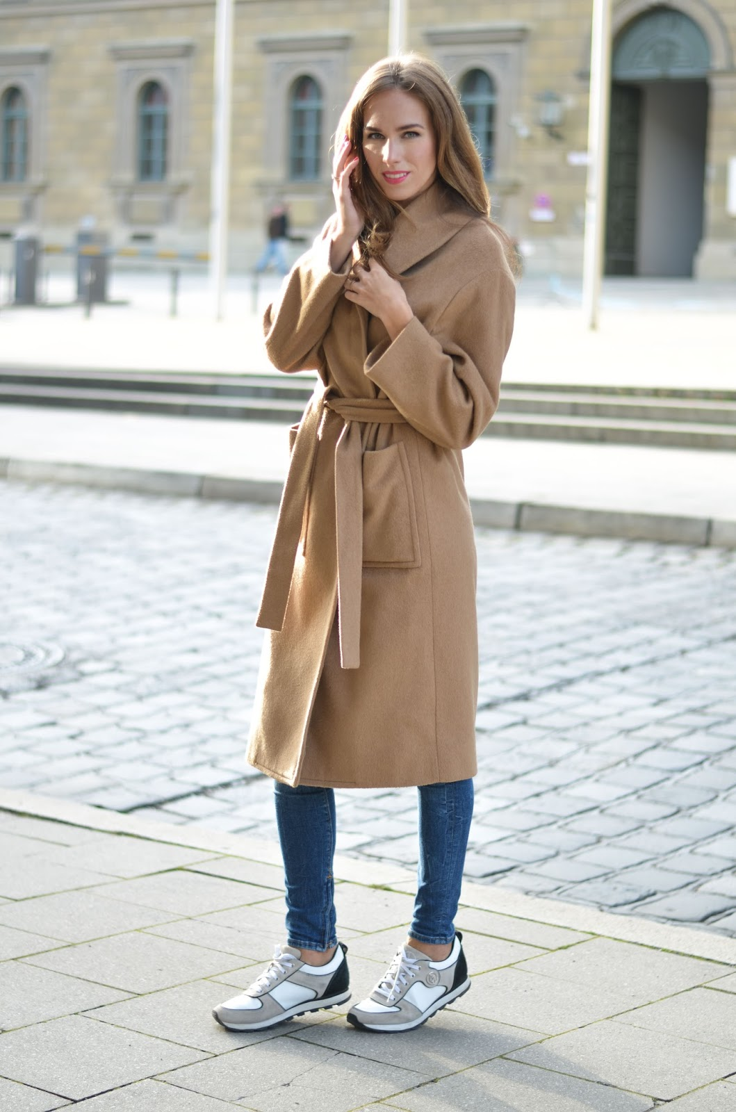kristjaana mere camel coat fall outfit with skinny jeans white sneakers