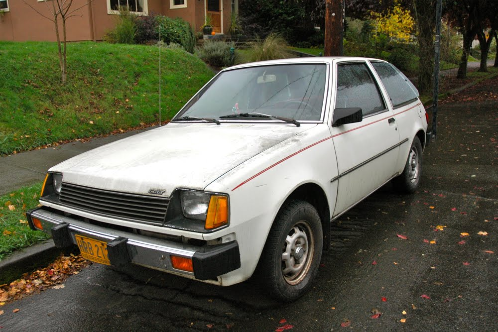OLD PARKED CARS.: 1983 Plymouth Colt.