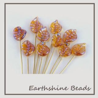 https://www.etsy.com/uk/listing/170690025/10-handmade-lampwork-glass-leaves-on?ref=shop_home_active