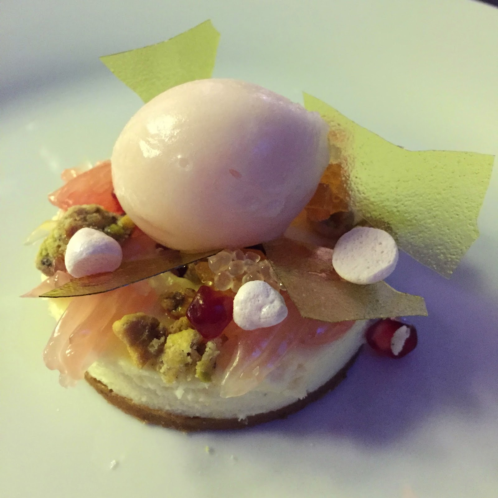 White chocolate cheesecake with pomelo, pomegranate, brown butter, and pistachio
