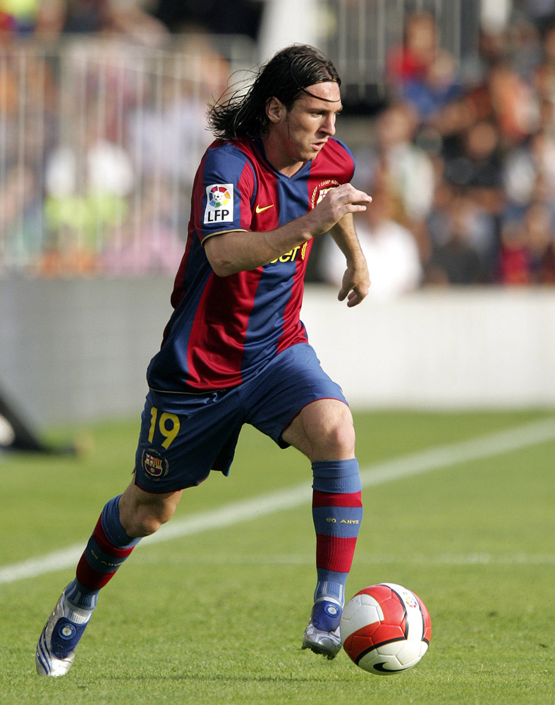World top sports players lionel messi in action wallpaper lionel messi in action wallpaper voltagebd Image collections