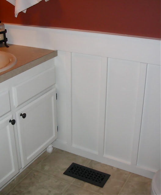 The yellow cape cod before after powder room makeover for Board and batten kitchen cabinets