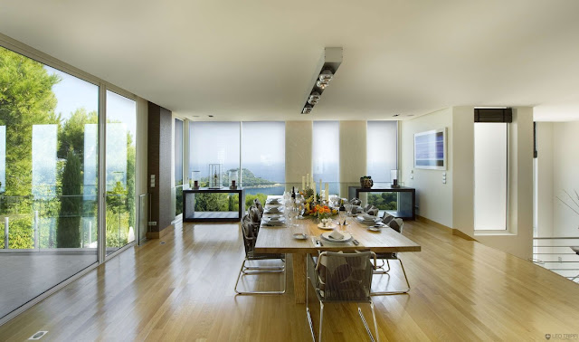 Large dining room with floor to ceiling windows