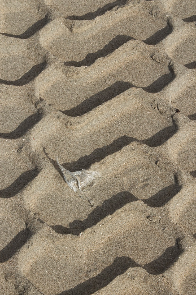 piece of plastic in sand