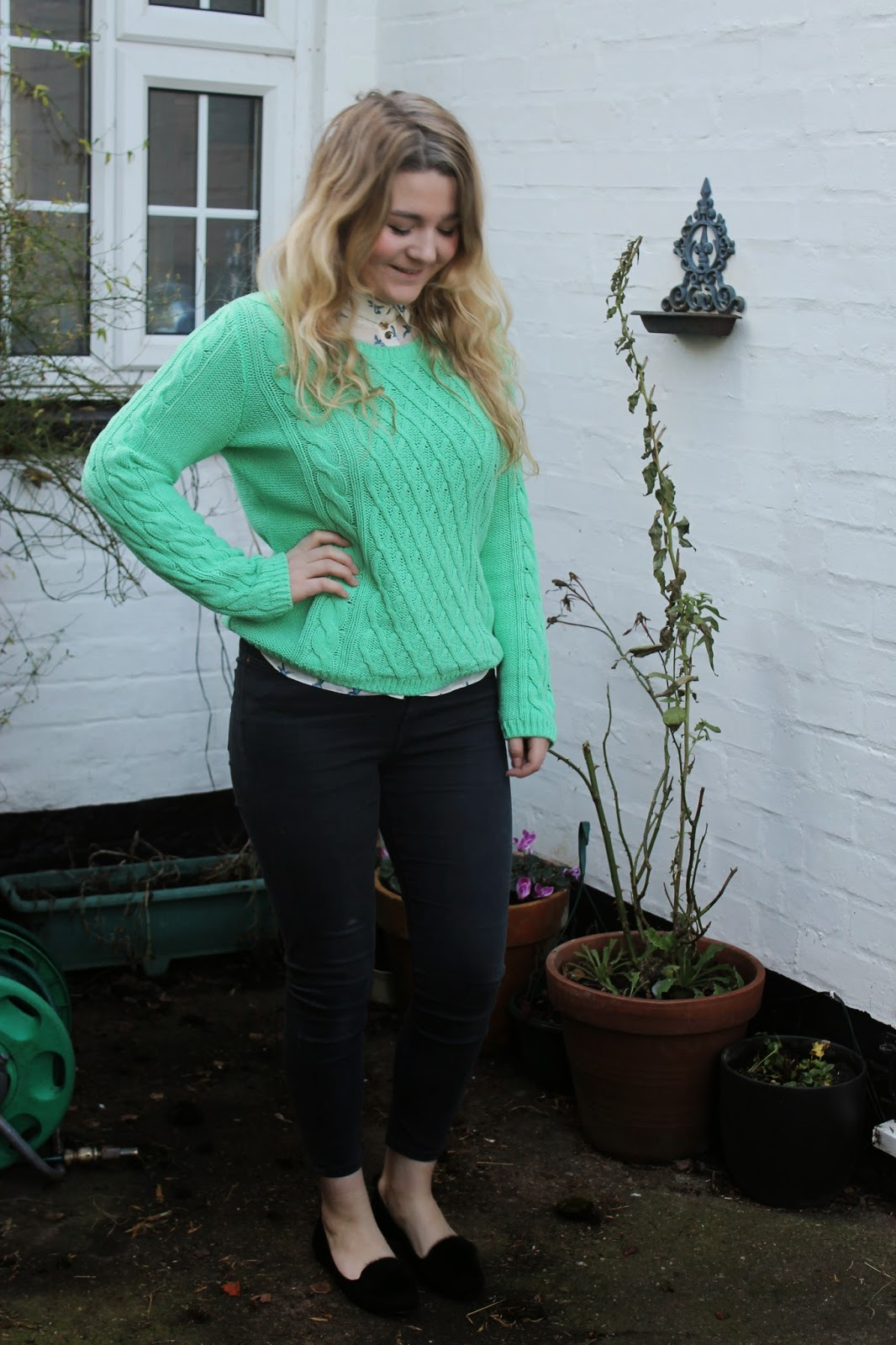 Green jumper and printed shirt