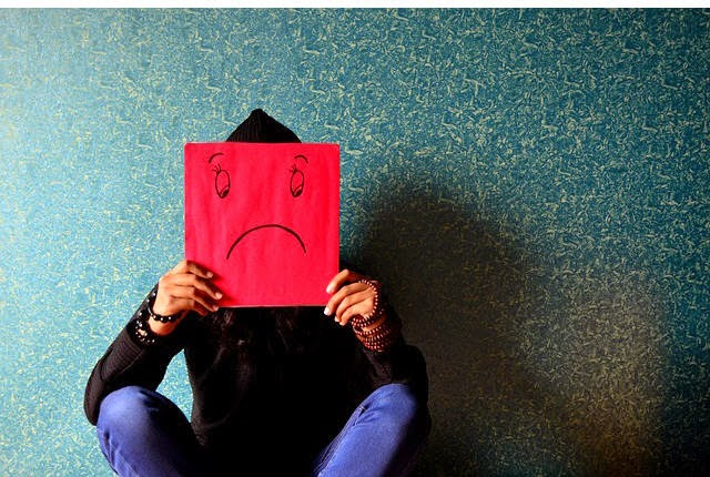 http://pixabay.com/en/unhappy-man-mask-sad-face-sitting-389944/