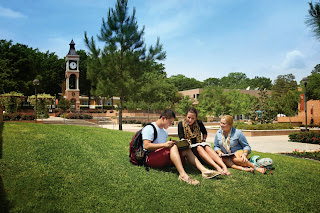 Students studying in front of the SHSU belltower