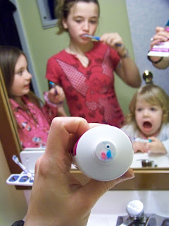 Three kids brushing teeth