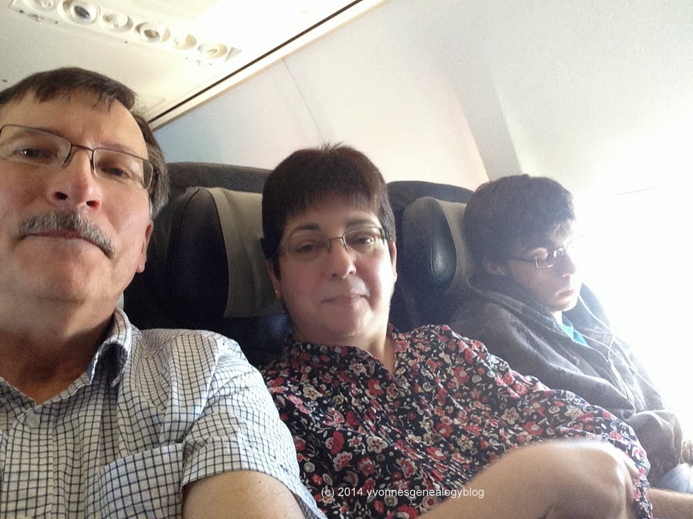 Tired trio on return flight home