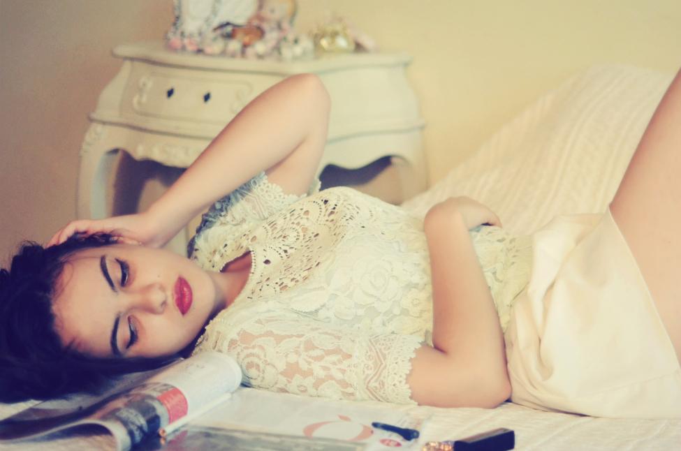 theserialshopper posing in a boudoir decor, portrait