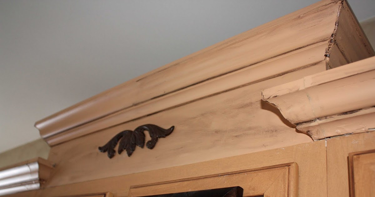 How to install crown molding on top of kitchen cabinets for Are kitchen cabinets installed on top of flooring