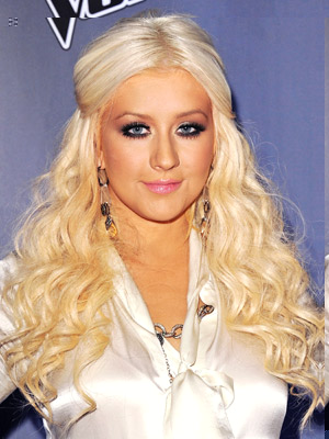 Christina Aguilera works diva-licious curls and a half-up hairstyle.