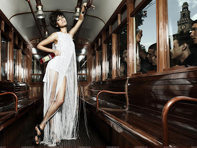 olga_kurylenko_hot_wallpaper_in_train_sweetangelonly.com