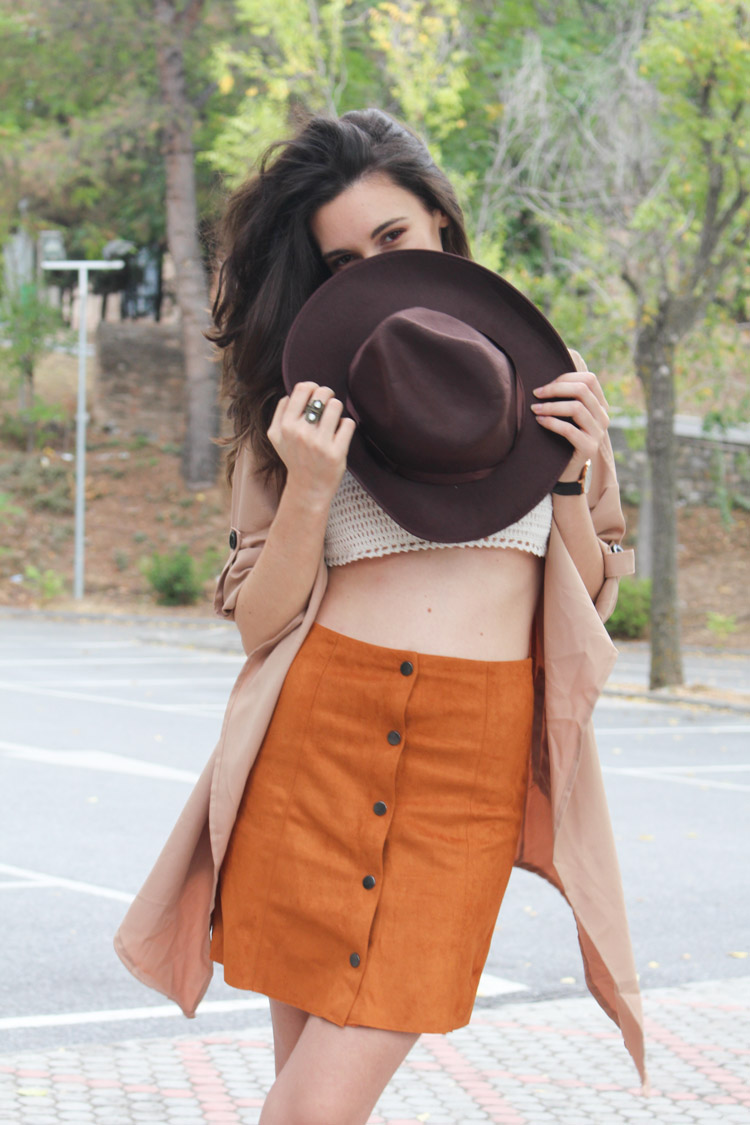Suede skirt, camel trench, hat, silver necklace, knit bikini