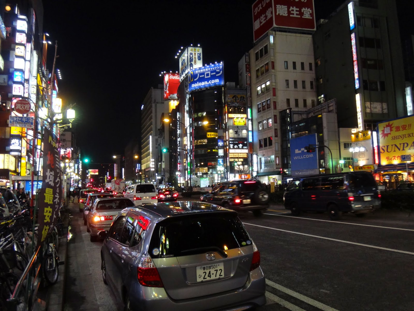Busy night traffic with crowded people at Shinjuku city (Kabukicho) of Tokyo, Japan