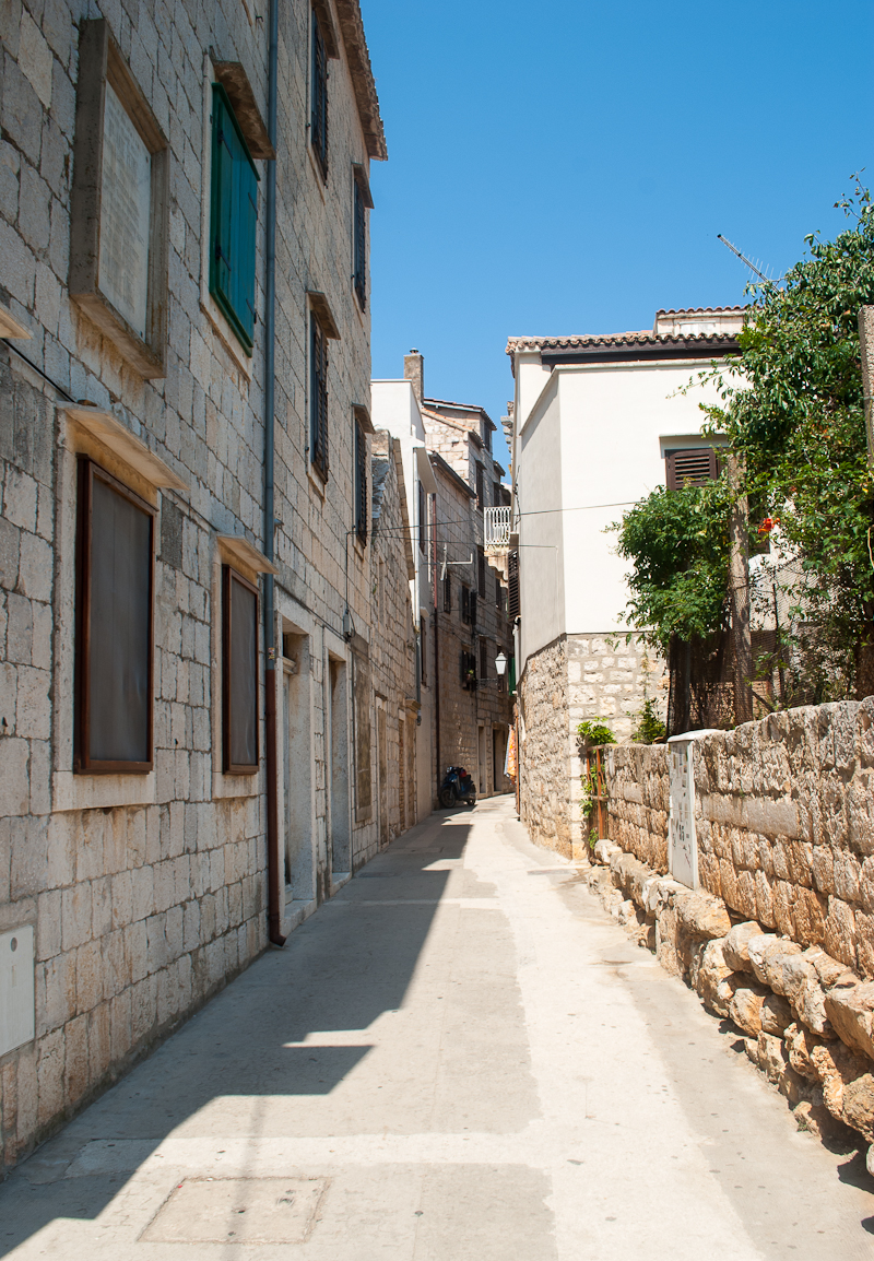 walking through the town of vis croatia with olden architecture