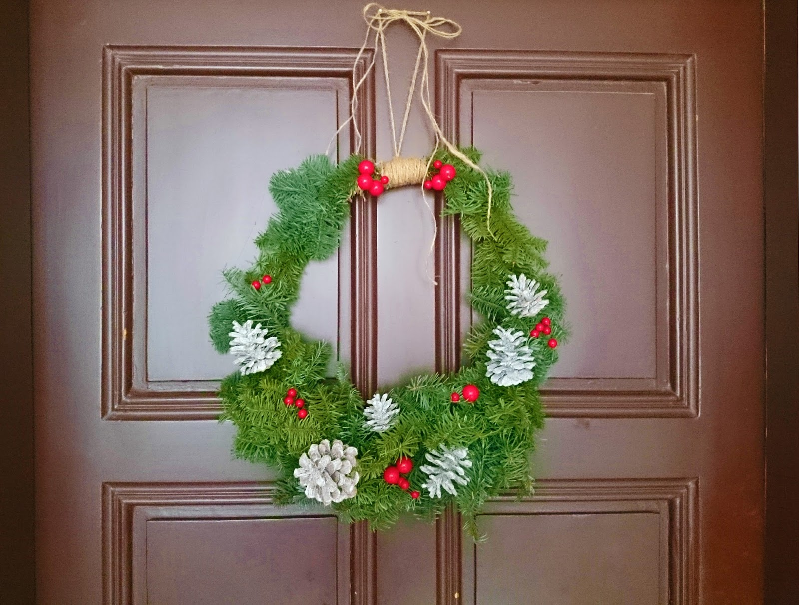 Diy winter wreaths for front door - I Still Hope That Someday I Ll Wake Up And Our Front Door Has Magically Changed Its Color Dark Blue But I Really Like How The Wreath Makes It A Lot