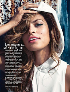 Eva Mendes wearing a sleeveless hooded sweater