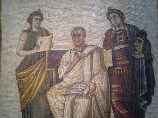 Virgilio y las Musas. A su derecha, Clío, la musa de la Historia; a su izquierda, y sosteniendo una máscara, Melpómene, la musa del Teatro Trágico - Mosaico romano - Museo del Bardo, Túnez