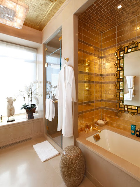 Bathroom with gold tiles and a step in tub