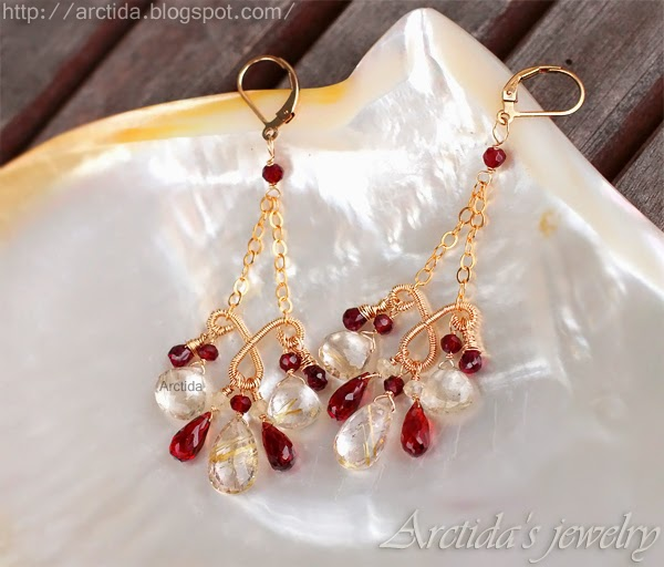 http://www.arctida.com/en/luxury/98-chandelier-earrings-citrine-amethyst-garnets-earrings-domani.html
