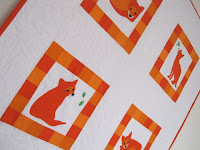 handmade fox quilt, orange and white