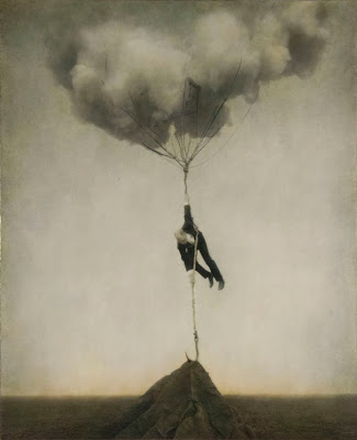 art photography of man tethered to cloud and earth