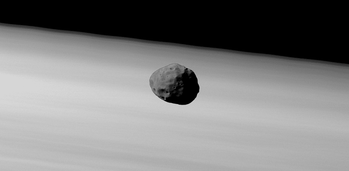 An image of Phobos by the High-Resolution Stereo Camera on board Mars Express on 22 January 2007. The larger and inner of the two martian moons is seen here floating just above the martian limb. The image has been enhanced slightly to bring out the detail on the moon. Credit: ESA/DLR/FU Berlin (G. Neukum)