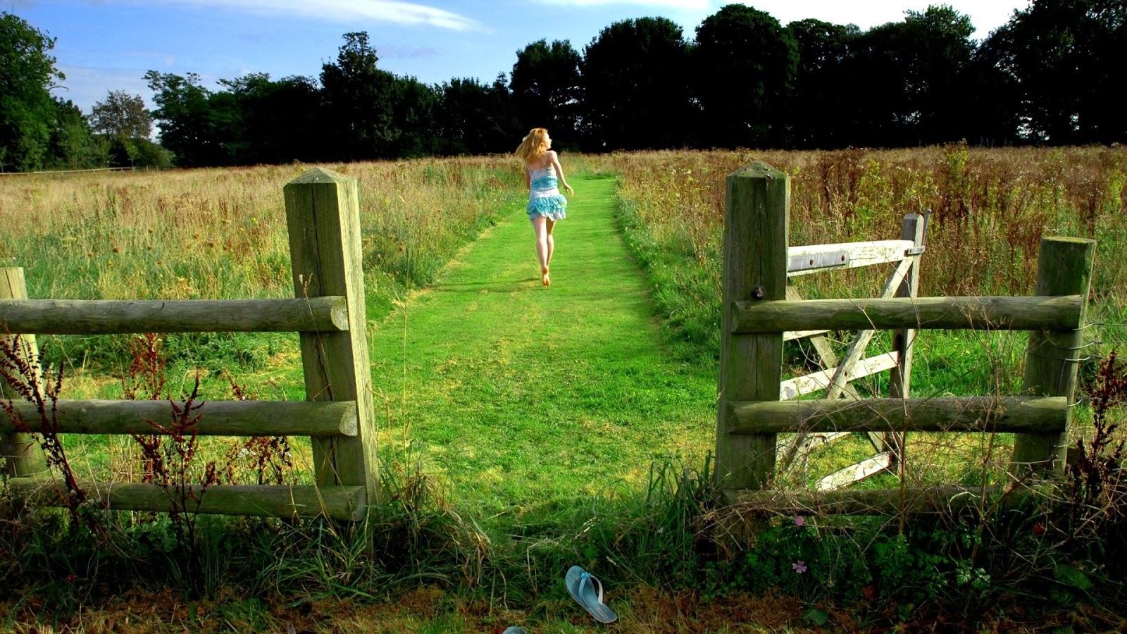 Girl Running Barefoot on Grass