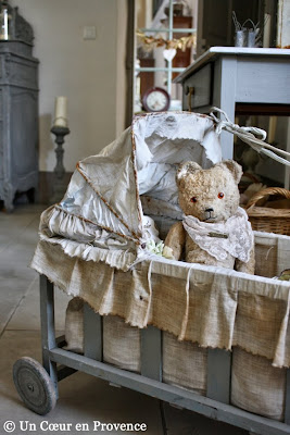 Teddy bear in a doll's pram