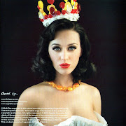 . indicates that Katy Perry is quite feminine and would appeal to young, .