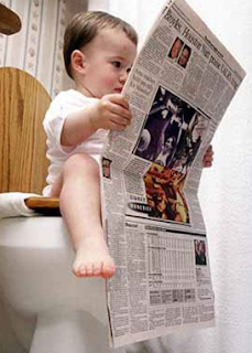 funny images: child reads newspaper on the toilet