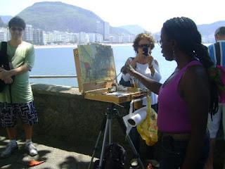 Sandra Nunes pintando no Encontro Mundial de Pintura ao ar Livre