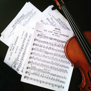 a violin and sheet music