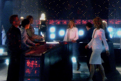 The Cylons deliberate their dumb plan