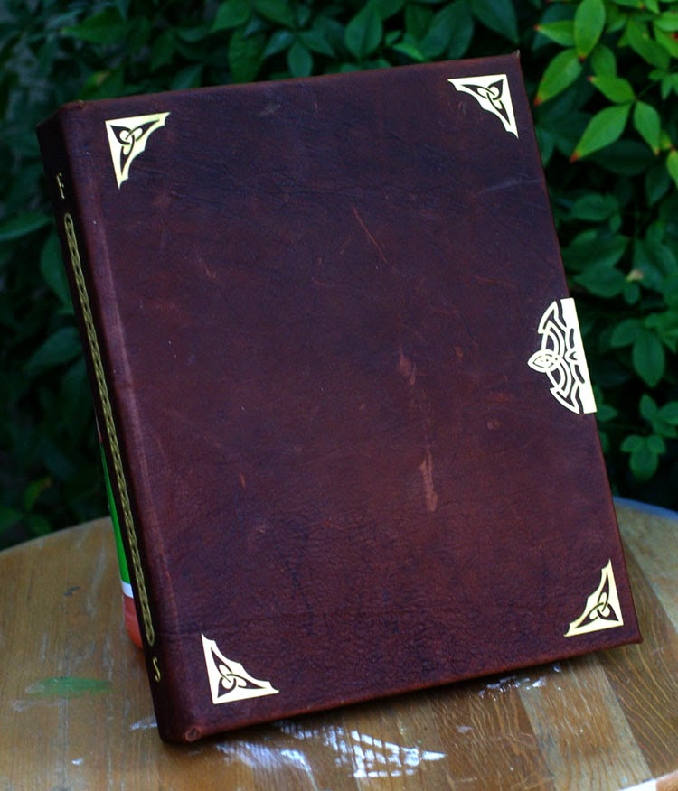 06-Leather-Bound-Book-Tim-Baker-Intricately-Designed-Book-Covers-www-designstack-co