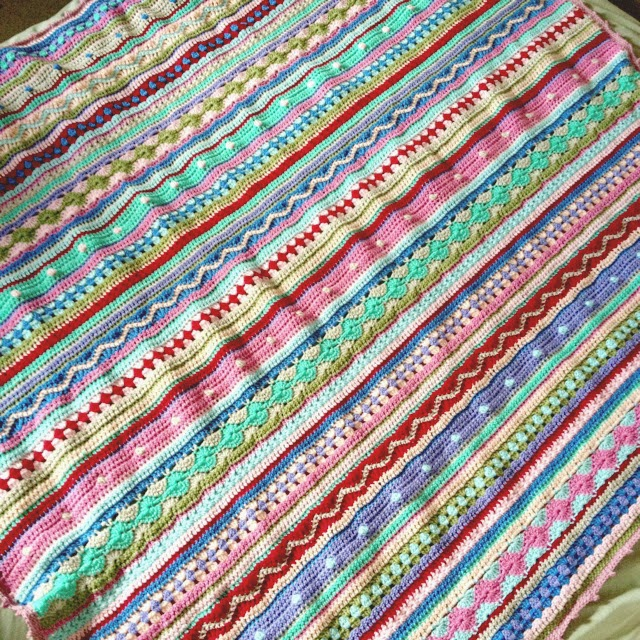 http://notyouraveragecrochet.com/as-we-go-stripey-blanket/