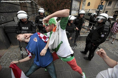 A Croatian And Irish Fans Joke In Front Of Polish Policemen In Poznan During Euro 2012 Match Between Croatia And Ireland