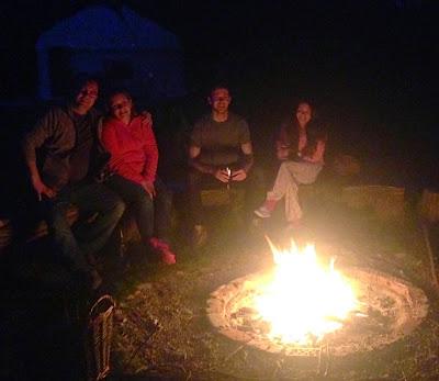 Acorn glade group around fire