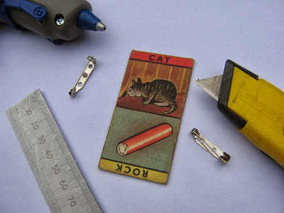 Picture Domino, brooch back, cutting knife, ruler, glue gun