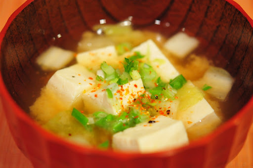 This miso soup has tofu and napa cabbage and it's topped off with ...