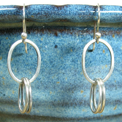 Cicada Silver:  Sterling silver oval earrings