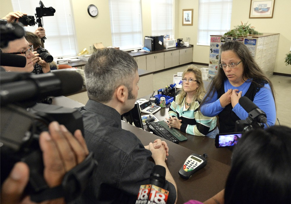 70 Of The Most Touching Photos Taken In 2015 - James Yates and William Smith are issued their marriage license in Rowan County following the arrest of Kim Davis, who had refused a Supreme Court order to do so.