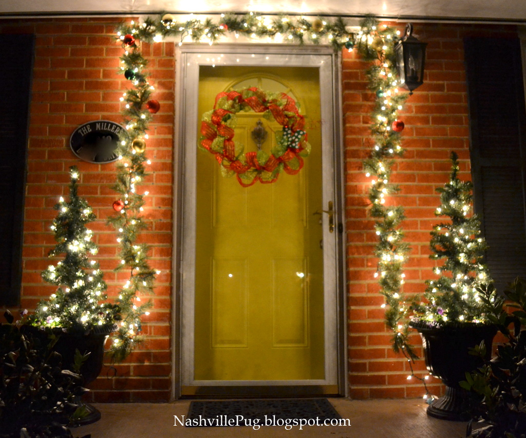 ... at night! I love how it just glows! And my yellow door is smiling too