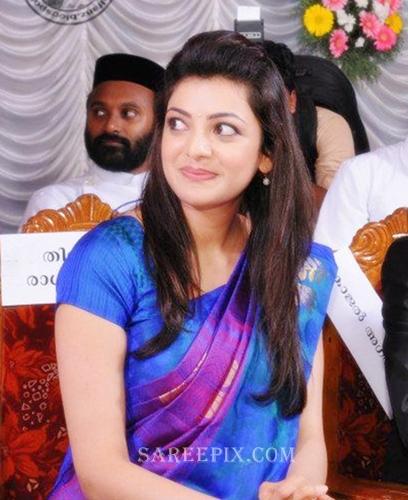 Kajal-agarwal-smile-saree-Karikkineth-silks-inauguration-Kottayam